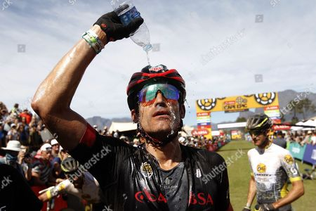 Former Tour de France rider George Hincapie from the United States celebrate winning the Master category  after the final stage of the 2017 ABSA Cape Epic mountain bike stage race over 103km, Paarl, South Africa, 26 March 2017.  The race is called the 'Tour de France' of mountain biking and sees 1200 riders racing over 691km during 8 stages and climbing twice the height of Mount Everest. The race sees the worlds best professional riders racing with amateur riders from 52 countries.