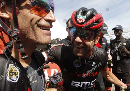 Former Tour de France winner, Australia's Cadel Evens (R) and partner, George Hincapie (L) from the United States celebrate celebrate winning the Master category  after the final stage of the 2017 ABSA Cape Epic mountain bike stage race over 103km, Paarl, South Africa, 26 March 2017.  The race is called the 'Tour de France' of mountain biking and sees 1200 riders racing over 691km during 8 stages and climbing twice the height of Mount Everest. The race sees the worlds best professional riders racing with amateur riders from 52 countries.