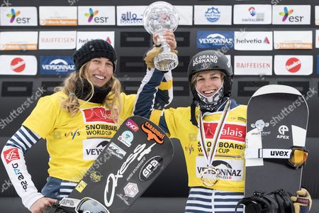 Winner Chloe Trespeuch and Nelly Moenne Loccoz from France celebrate on the podium with the Overall  trophy during the FIS Snowboard World Cup in Veysonnaz, Switzerland, 26 March 2017.