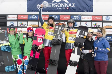 (L-R) second placed Michela Moioli and Raffaella Brutto from Italy, winner Nelly Moenne Loccoz and Chloe Trespeuch from France, and third placed  Colleen Healey and Rosina Mancari form the USA celebrate on the Overall podium during the FIS Snowboard World Cup in Veysonnaz, Switzerland, 26 March 2017.