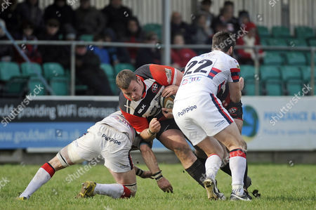 Cornish Pirates, prop Jack Andrew tackled between Doncaster Knights, flanker and skipper Michael Hills and Doncaster Knights, fly-half Declan Cusack during the match between the Cornish Pirates and Doncaster Knights in the Rugby Championship at the Mennaye Field, Penzance, Cornwall.