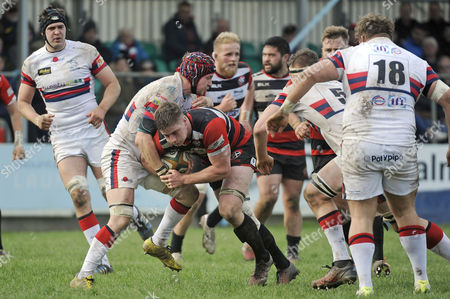 Cornish Pirates, flanker Dan Lee is tackled by Doncaster Knights, flanker and skipper Michael Hills during the match between the Cornish Pirates and Doncaster Knights in the Rugby Championship at the Mennaye Field, Penzance, Cornwall.