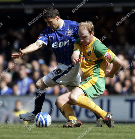 Jon Walters of Ipswich town challenges Gary Doherty of Norwich City