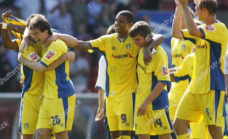 Ben Parker, Jermaine Beckford and Jonathan Howson of Leeds United celebrate after the game