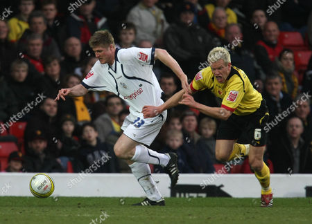 Neil Mellor of Preston North End tries to get away, as Jay DeMerit of Watford tugs on his shirt