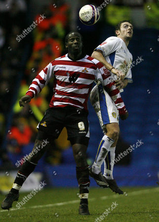 Mark McCammon of Doncaster Rovers and Frazer Richardson of Leeds United jump for a header