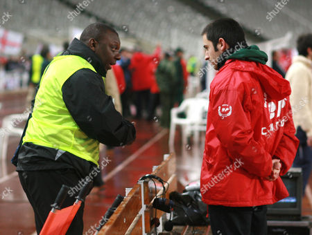 Television pundit and former player Garth Crooks, left, has an argument with a steward