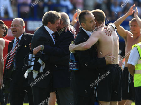 Fulham owner Mohamed al Fayed celebrates at full time with manager Roy Hodgson as Deputy managing director Mark Collins, far left, celebrates and Chief Executive David McNally, right, hugs scorer Danny Murphy