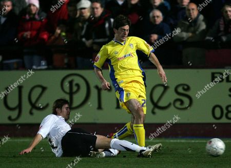 Ben Parker of Leeds United is tackled by John McCombe of Hereford United