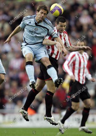 Ian Harte of Sunderland and Michael Owen of Newcastle United
