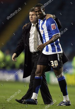 Scorer of the winning goal Akpo Sodje of Sheffield Wednesday celebrates with his manager at the end of the game