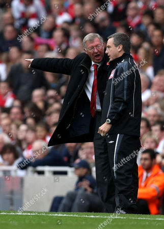 Manchester United manager Sir Alex Ferguson shouts at fourth official Alan Wiley on the touchline