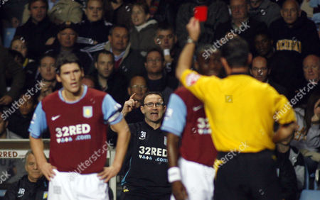 Aston Villa manager Martin O' Neill reacts as Nigel Reo-Coker is shown the red card by referee Rob Styles