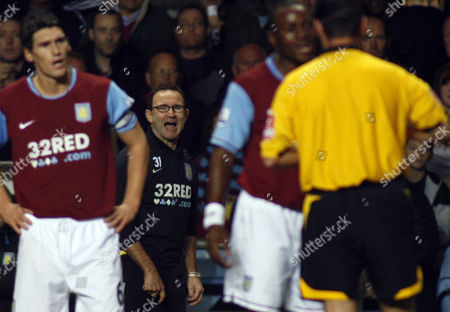 Aston Villa manager Martin O' Neill shouts at referee Rob Styles as he is about to book Nigel Reo-Coker for the second time