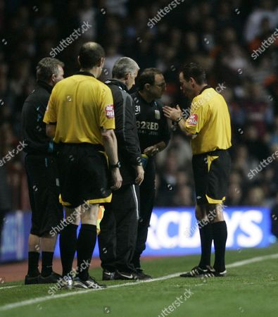 Aston Villa manager Martin O' Neill speaks to referee Rob Styles after Nigel Reo-Coker was sent off