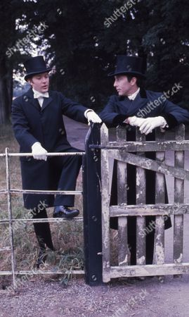 Anthony Valentine (as A.J. Raffles) and Christopher Strauli (as Bunny Manders)