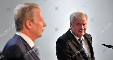 Bavarian Prime Minister Horst Seehofer (R) and Austrian Vice Chancellor and OeVP-leader Reinhold Mitterlehner during a press statement at the CSU headquarters in Munich, Bavaria, Germany, 27 March 2017. Seehofer and Mitterlehner met for a general exchange of views.