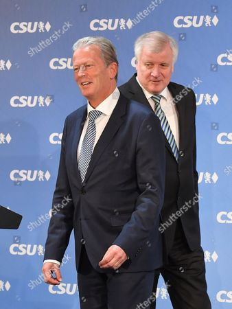 Bavarian Prime Minister Horst Seehofer (R) and Austrian Vice Chancellor and OeVP-leader Reinhold Mitterlehner arrive for a press statement at the CSU headquarters in Munich, Bavaria, Germany, 27 March 2017. Seehofer and Mitterlehner met for a general exchange of views.