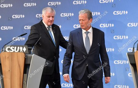 Bavarian Prime Minister Horst Seehofer (L) and Austrian Vice Chancellor and OeVP-leader Reinhold Mitterlehner arrive for a press statement at the CSU headquarters in Munich, Bavaria, Germany, 27 March 2017. Seehofer and Mitterlehner met for a general exchange of views.