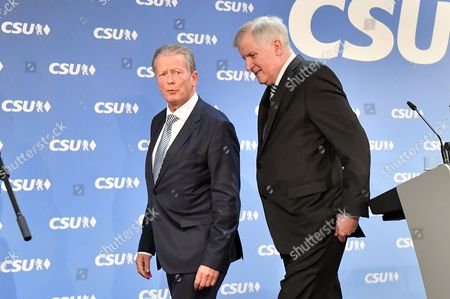 Bavarian Prime Minister Horst Seehofer (L) and Austrian Vice Chancellor and OeVP-leader Reinhold Mitterlehner leave after a press statement at the CSU headquarters in Munich, Bavaria, Germany, 27 March 2017. Seehofer and Mitterlehner met for a general exchange of views.