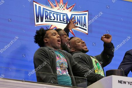 Xavier Woods, Kofi Kingston, Big E WrestleMania 33 participants Xavier Woods, left, Kofi Kingston, center, and Big E of The New Day, ring the New York Stock Exchange opening bell