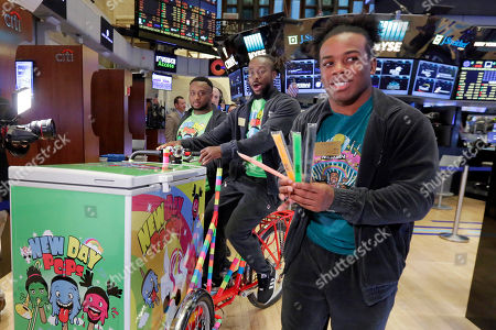Xavier Woods, Kofi Kingston, Big E WrestleMania 33 participants Big E, left, Kofi Kingston, center, and Xavier Woods of The New Day, hand out ice pops on the New York Stock Exchange trading floor, before ringing the opening bell