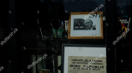 A memorial to the Martin McGuinness in a Sinn Fein political party shop window on the Falls Road in Belfast, Northern Ireland, . The death last week of Martin McGuinness, the Irish Republican Army commander who led his underground paramilitary movement toward reconciliation with Britain, highlighted the progress that has been made in Northern Ireland, yet how far there is still to go