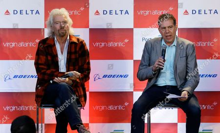 Stock Photo of Sir Richard Branson, left, founder of Virgin Atlantic and the Virgin Group, listens as Craig Kreeger, right, CEO of Virgin Atlantic speaks at a news conference, at Seattle-Tacoma International Airport in Seattle. Branson was in Seattle to help launch Virgin Atlantic's new daily service between London Heathrow and Seattle, replacing flights currently operated by Virgin partner Delta Air Lines