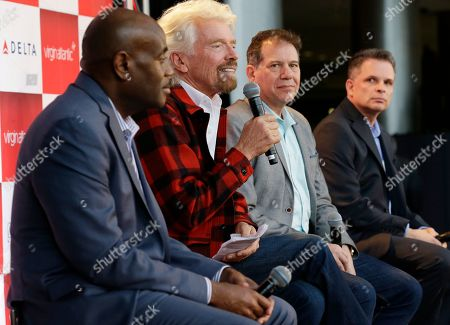 Stock Picture of Richard Branson, second from left, founder of Virgin Atlantic and the Virgin Group, speaks at a news conference as he sits with Lance Lyttle, left, Managing Director of the Port of Seattle, Craig Kreeger, second from right, CEO of Virgin Atlantic, and John Caldwell, right, Seattle vice president of Delta Air Lines, at Seattle-Tacoma International Airport in Seattle