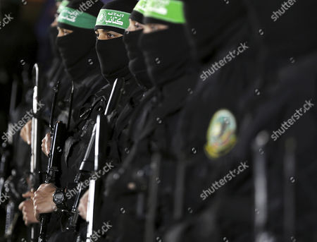 Fighters from the Ezz-Al Din Al Qassam Brigades, the armed wing of the Palestinian Hamas movement, attend the memorial service for Mazen Faqhaa, senior leader of Ezz-Al Din Al Qassam Brigades, the armed wing of the Palestinian Hamas movement, in Gaza City, Gaza Strip, 27 March 2017. Mazen Faqhaa was killed on 24 March 2017 after gunmen shot dead him near his home in the Tal Al-Hawa neighborhood of Gaza City.  Faqhaa was freed by Israeli in 2011 prisoner swap with more than 1,000 other Palestinian prisoners in exchange for Gilad Shalit, an Israeli soldier Hamas had detained for five years. Hamas officials have said the killing bears the hallmarks of Israel's intelligence service Mossad, but Israel has not commented on the shooting.