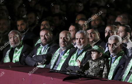 The new leader of Hamas movement in Gaza Strip Yahya Sinwar (R), seated with the son of Mazen Faqhaa, senior leader of Ezz-Al Din Al Qassam Brigades, the armed wing of the Palestinian Hamas movement; senior Hamas leader Sheikh Ismail Haniya (2-R), senior Hamas leader Khalil Al-Hayya (C), senior Hamas leader Fathi Hamad (2-L) and senior Hamas leader Dr. Mahmoud Al-Zahar (L) attend a memorial service in Gaza City, Gaza Strip, 27 March 2017. Mazen Faqhaa was killed on 24 March 2017 after gunmen shot dead him near his home in the Tal Al-Hawa neighborhood of Gaza City.  Faqhaa was freed by Israeli in 2011 prisoner swap with more than 1,000 other Palestinian prisoners in exchange for Gilad Shalit, an Israeli soldier Hamas had detained for five years. Hamas officials have said the killing bears the hallmarks of Israel's intelligence service Mossad, but Israel has not commented on the shooting.