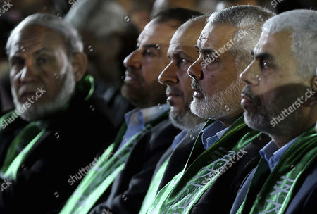 The new leader of Hamas movement in Gaza Strip Yahya Sinwar (R), senior Hamas leader Sheikh Ismail Haniya (2-R), senior Hamas leader Khalil Al-Hayya (C), senior Hamas leader Fathi Hamad (2-L) and senior Hamas leader Dr. Mahmoud Al-Zahar (L) attend a memorial service for Mazen Faqhaa, slain senior leader of the Ezz-Al Din Al Qassam Brigades, the armed wing of the Palestinian Hamas movement, in Gaza City, Gaza Strip, 27 March 2017. Mazen Faqhaa was killed on 24 March 2017 after gunmen shot dead him near his home in the Tal Al-Hawa neighborhood of Gaza City.  Faqhaa was freed by Israeli in 2011 prisoner swap with more than 1,000 other Palestinian prisoners in exchange for Gilad Shalit, an Israeli soldier Hamas had detained for five years. Hamas officials have said the killing bears the hallmarks of Israel's intelligence service Mossad, but Israel has not commented on the shooting.