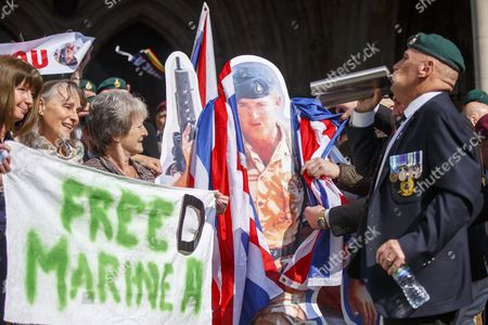Campaigners and supporters of Sgt Blackman, known as Marine A, celebrate the high court ruling outside the Royal Courts of Justice in London