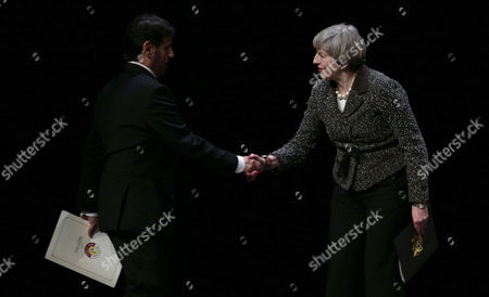 Theresa May Prime Minister greets Prime Minister of Qatar Sheikh Abdullah bin Nasser bin Khalifa Al Thani at the UK-Qatar trade and investment conference at The Library of Birmningham