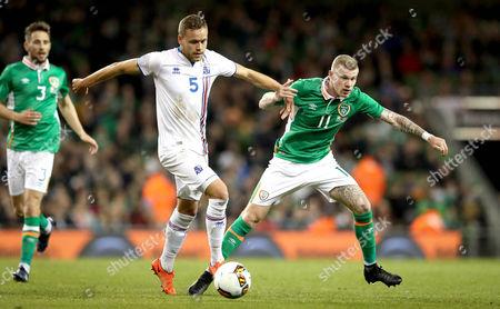 Republic of Ireland vs Iceland. Ireland's James McClean and Sverrir Ingi Ingason of Iceland