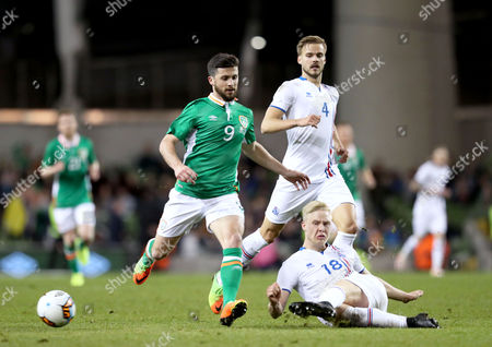 Republic of Ireland vs Iceland. Ireland's Shane Long with Hordur Bjorgvin Magnusson of Iceland