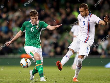 Republic of Ireland vs Iceland. Ireland's Stephen Gleeson with Sverrir Ingi Ingason of Iceland