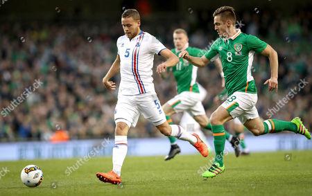 Republic of Ireland vs Iceland. Ireland's Kevin Doyle and Sverrir Ingi Ingason of Iceland