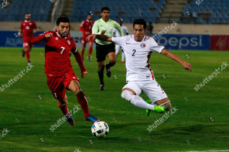 Lebanon's Hassan Maatouk, left, competes for the ball with Hong Kong's Lee Chi Ho during the AFC Asian Cup 2019 Group B qualification soccer match between Lebanon and Hong Kong, at the City Sport stadium in Beirut, Lebanon