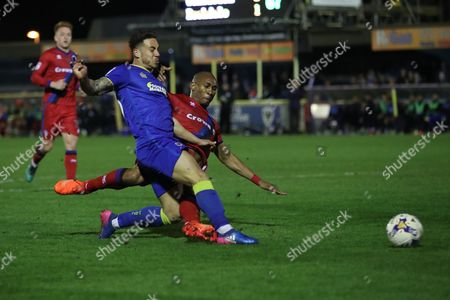 AFC Wimbledon midfielder David Fitzpatrick (19) and Rochdale striker Calvin Andrew (9) during the EFL Sky Bet League 1 match between AFC Wimbledon and Rochdale at the Cherry Red Records Stadium, Kingston