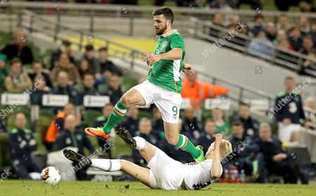 Republic of Ireland vs Iceland. Republic of Ireland's Shane Long with Hordur Bjorgvin Magnusson of Iceland
