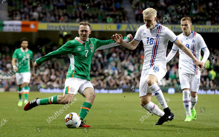 Republic of Ireland vs Iceland. IrelandÕs Aiden McGeady and Hordur Bjorgvin Magnusson of Iceland