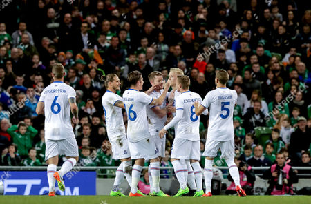 Republic of Ireland vs Iceland. Iceland's Hordur Bjorgvin Magnusson celebrates scoring the first goal of the game with teammates