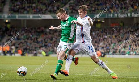 Stock Photo of Republic of Ireland vs Iceland. Republic of Ireland's Jonny Hayes with Olafur Ingi Skulason of Iceland