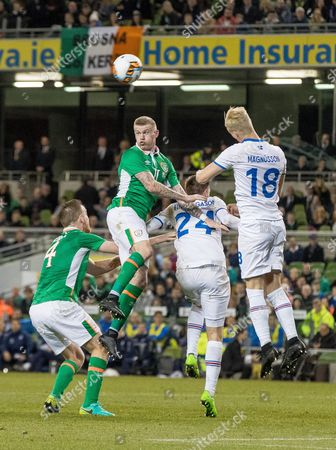 Republic of Ireland vs Iceland. Republic of Ireland's James McClean and Alex Pearce with Kjartan Henry Finnbogason and Hordur Bjorgvin Magnusson of Iceland