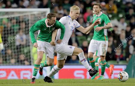 Republic of Ireland vs Iceland. Republic of Ireland's Aiden McGeady with Hordur Bjorgvin Magnusson of Iceland