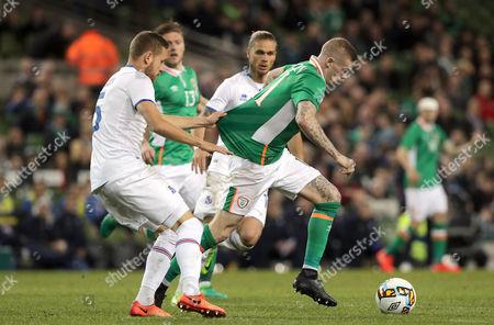 Republic of Ireland vs Iceland. Republic of Ireland's James McClean with Sverrir Ingi Ingason of Iceland