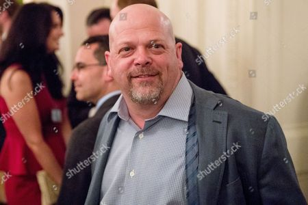 Rick Harrison, who appears on the television show Pawn Stars, arrives for a reception for Senators and their spouses in the East Room of the White House, in Washington