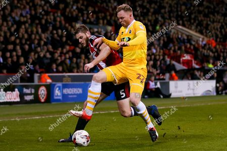 Sheffield United defender Jack O?Connell (5) is tackled by Millwall striker Aiden O'Brien (22)  during the EFL Sky Bet League 1 match between Sheffield Utd and Millwall at Bramall Lane, Sheffield