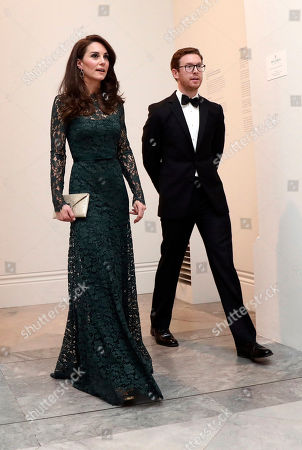 Catherine Duchess of Cambridge is escorted by gallery director Nicholas Cullinan at the 2017 Portrait Gala, a fundraising event, at the National Portrait Gallery in London